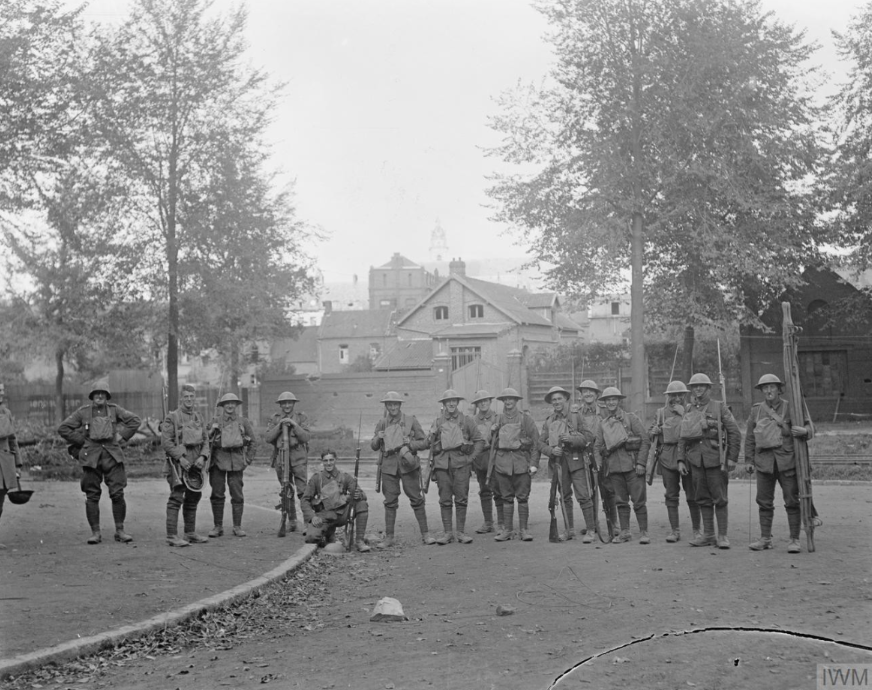 Capture of Cambrai by the British 57th Division, Soldiers of the Loyal North Lancashire Regiment on return from a patrol in Cambrai, 9 October 1918. © IWM Q 11366