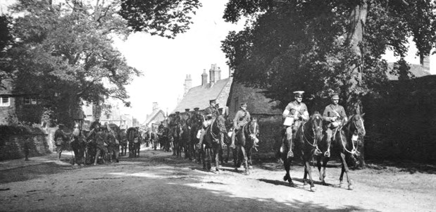 Manoeuvres, 1913. A Royal Artiller column passing through a Buckinghamshire village (Photo: NAM 15495)