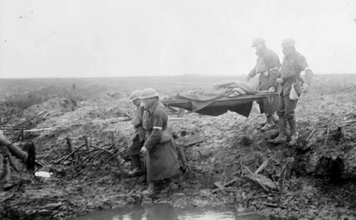 Stretcher bearers carry wounded to the aid-post, Third Ypres, November 1917